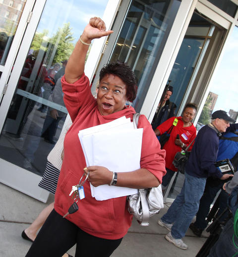 Stephanie Hayes of Ashe Elementary School reacts to the news that delegates for the Chicago Teachers Union voted to suspend the strike.