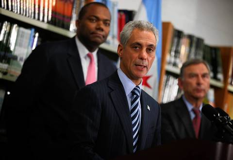Chicago Mayor Rahm Emanuel (center), joined by Chicago Public Schools CEO Jean-Claude Brizard (left) and Chicago Board of Education President David Vitale (right), makes a brief statement about the suspension of the Chicago Teachers Union strike at Walter Payton College Prep in Chicago.