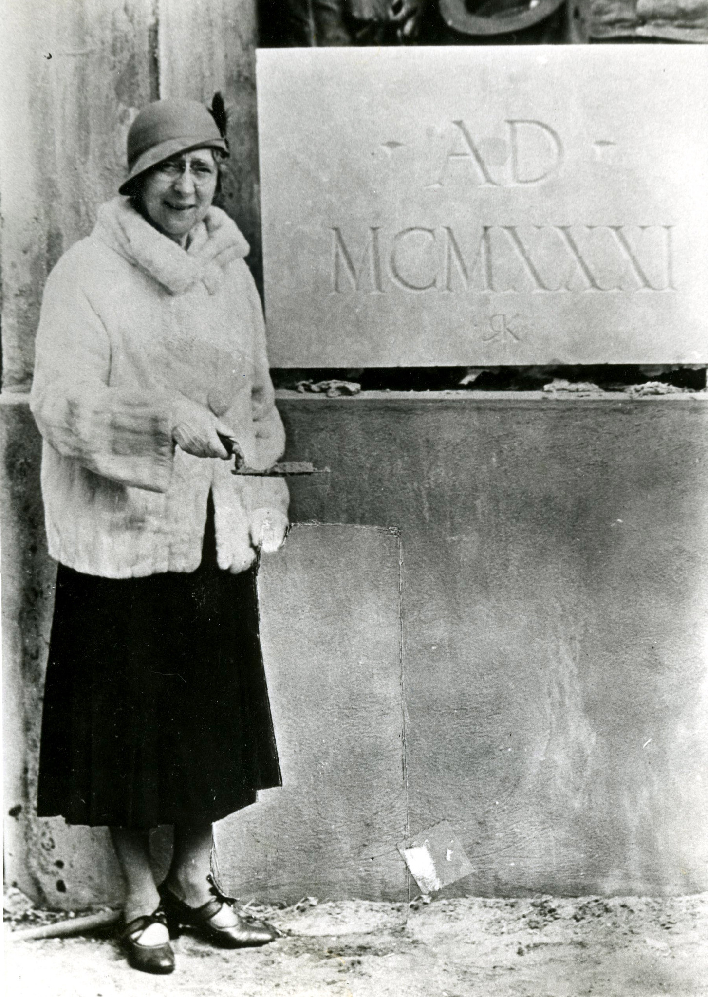 Annie Russell, trowel in hand, attended a 1931 ceremony at which the cornerstone was laid for the Rollins College theater that bears her name.