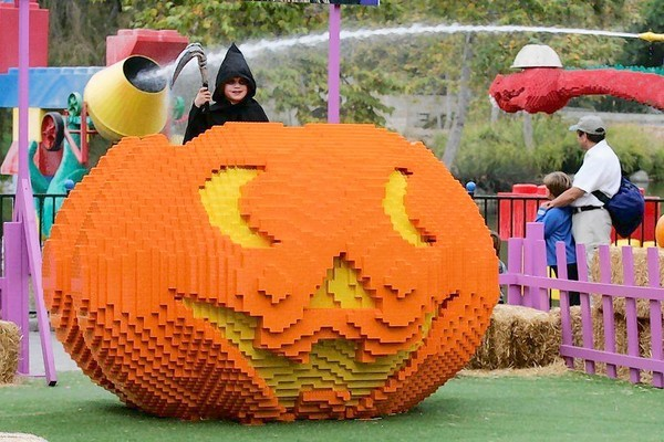 A giant pumpkin constructed of Lego pieces is part of Legoland Florida's Brick or Treat festivities.