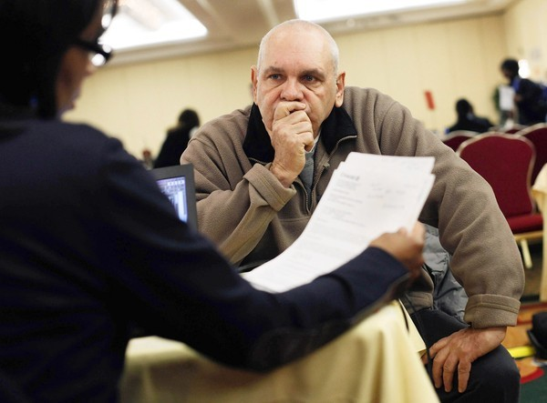 Donald Bonner speaks with a mortgage specialist at a foreclosure consultation event in New York in 2011.