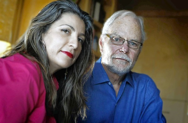 Julie and Bill Ruehle in their home office in Carlsbad, Calif. Bill Ruehle, Broadcom's former chief financial officer, has published a book describing his ordeal and exoneration in an options-backdating case.
