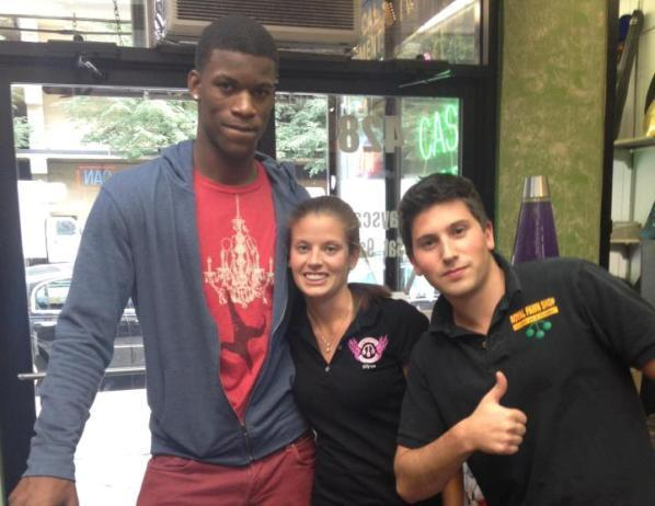 The Bulls' Jimmy Butler (left) poses for a photo at Royal Pawn Shop with employees Elyse Cohen (center) and Nathan Cohen (right).