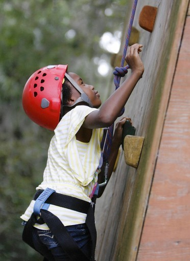 Taylor Clark, 7, climbs the climbing wall at Camp Wewa in Apopka, Fla. Saturday, September 22, 2012.  The YMCA of Central Florida, along with the Florida Blue and regions Jack and Jill group, is sponsoring a World Wide Day of Play event on Saturday Sept. 22 to focus on getting kids moving and fighting obesity at Camp Wewa in Apopka, Fla.  (Gary W. Green/Orlando Sentinel) ORG XMIT: B582378539Z.1