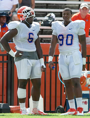 Defensive linemen Dante Fowler, Jr. (6) and Jonathan Bullard (90) are among several freshmen who have stepped up for the Gators this season.