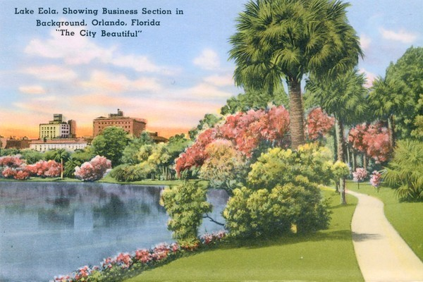 A linen-era postcard from the 1940s features a sunset view of Orlando's downtown skyline during the era when many homes still surrounded Lake Eola Park on the north, south and east.