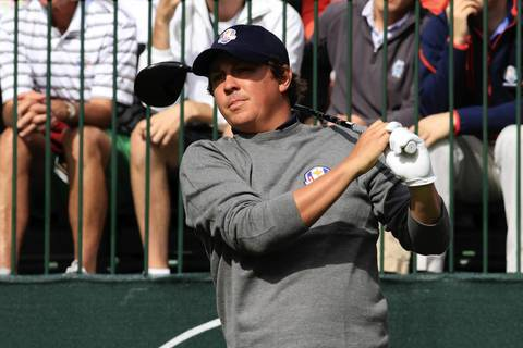 Jason Dufner watches the ball flight after teeing off on the first hole at Medinah Country Club during the first day of practice for the 2012 Ryder Cup.