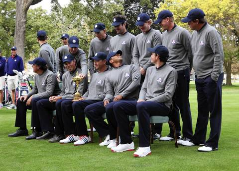 Someone behind Tiger Woods, looking back, popped his cap forward during the team photo on the second preview day of The 39th Ryder Cup at Medinah Country Golf Club. The USA team includes: Front row L-R: Phil Mickelson, Matt Kuchar, Davis Love III (captain), Tiger Woods and Keegan Bradley. Back row: L-R: Zach Johnson, Webb Simpson, Jim Furyk, Bubba Watson, Dustin Johnson, Brandt Snedeker, Steve Stricker, Jason Dufner