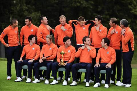 The European Ryder Cup Team adjust their clothing as they prepare to pose for a group photo at Medinah Country Golf Club in Medinah, Ill., ahead of the 39th Ryder Cup. (L to R Top) Sergio Garcia of Spain, Martin Kaymer of Germany, Lee Westwood of England, Peter Hanson of Sweden, Ian Poulter of England, Justin Rose of England, Nicolas Colsaerts of Belgium, Paul Lawrie of Scotland. (L to R Bottom) Rory McIlroy of Northern Ireland, Luke Donald of England, Jose Maria Olazabal of Spain, Graeme McDowell of Northern Ireland, Francesco Molinari of Italy.