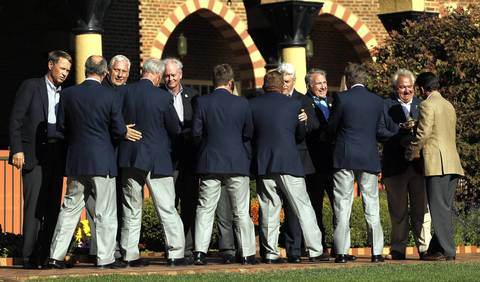 Ryder Cup Chairman Don Larson (second from right) greets European captain Jose Maria Olazabal (right) as Olazabal arrives with the Ryder Cup in hand at the Medinah Country Club in Medinah, Ill. At far left is United States' captain Davis Love III.