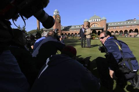 Photographers jostle for position as United States' captain Davis Love III (left) and European captain Jose Maria Olazabal (holding the Ryder Cup) pose at the Medinah Country Club.