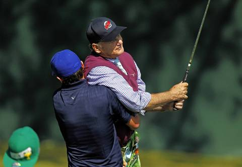 Actor/singer Justin Timberlake carries Bill Murray off of the second tee after Murray hits the ball at the 2012 Ryder Cup Captain/Celebrity Pairings at the Medinah Country Club.