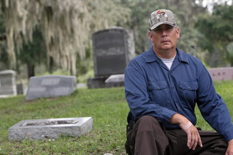Owl Goingback is head caretaker at Greenwood Cemetery near downtown Orlando and an author of horror novels.