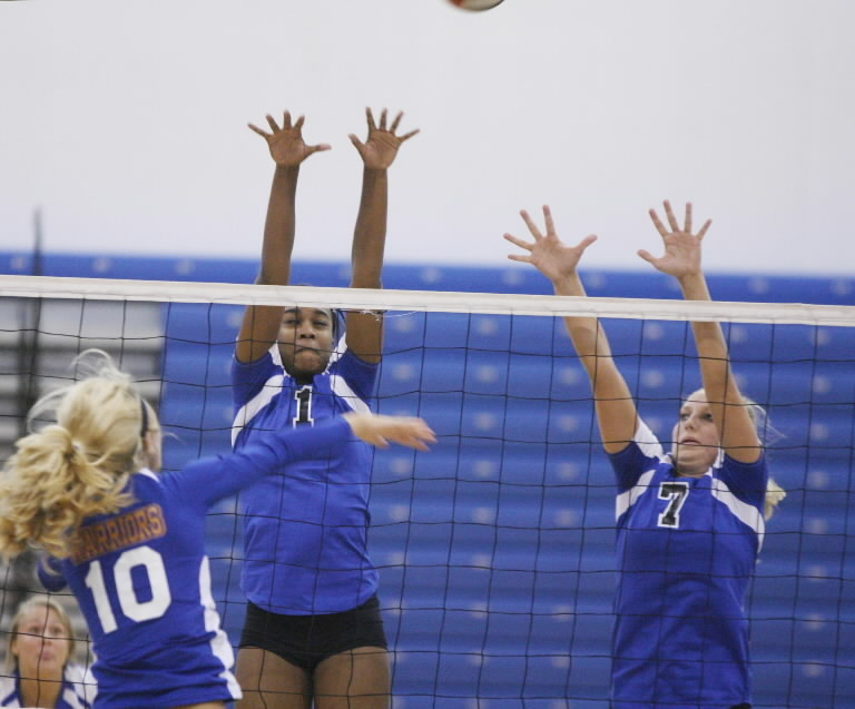 Denise Belcher, left, and Kacie Miller leap to block a shot for Apopka during a 3-0 (25-23, 25-17, 25-16) sweep of West Orange on Tuesday. (Stephen M. Dowell/Orlando Sentinel)