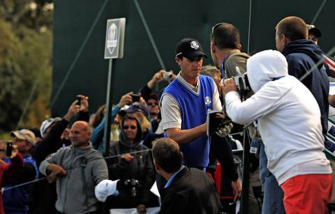 European Ryder Cup Nicolas Colsaerts signs autographs as Group 2 finishes the second hole during the second day of team practice at the Medinah Country Club