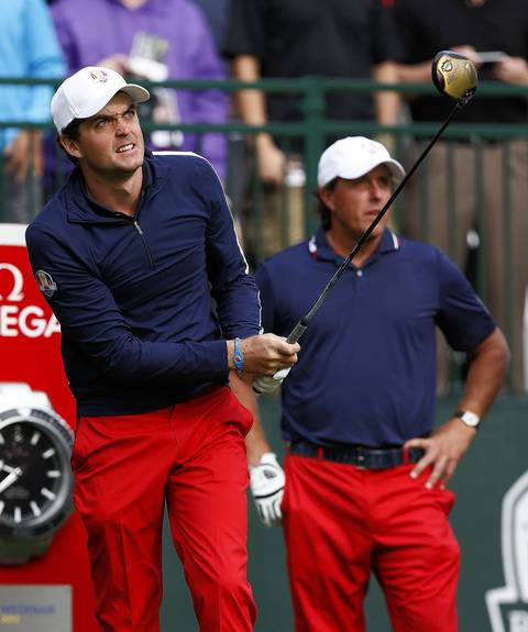 USA Ryder Cup teammates Keegan Bradley, left, and Phil Mickelson watch Bradley's drive off the first tee during the second day of team practice at Medinah Country Club.