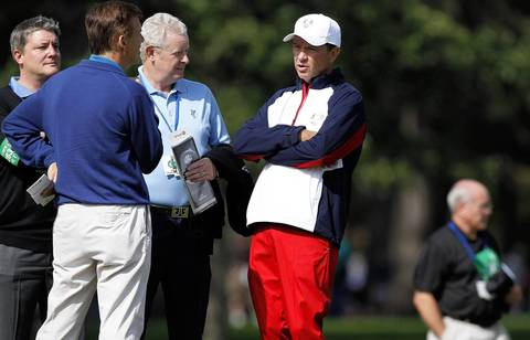 USA Ryder Cup Team Captain Davis Love III, middle wearing white cap, has a conversation on the ninth hole as the U.S team Group 3 practices at the Medinah Country Club.