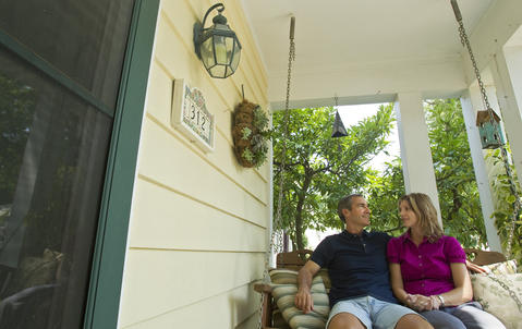 "Jim and Karen Garner sit on the porch swing at their home in Hilton. Jim is diagnosed with ""mild cognitive impairment,"" the preliminary stage of early onset Alzheimer's."