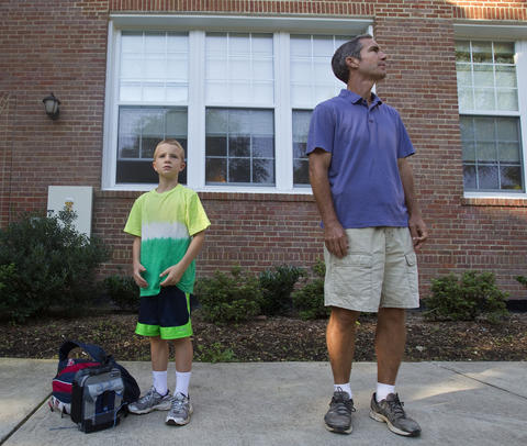 Bradley and Jim Garner wait for the morning bell to ring outside of Hilton Elementary School.