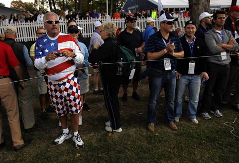 Spectators line the first fairway waiting for either the USA or European Ryder Cup Teams during Thursday's practice round at the 2012 Ryder Cup at Medinah Country Club.
