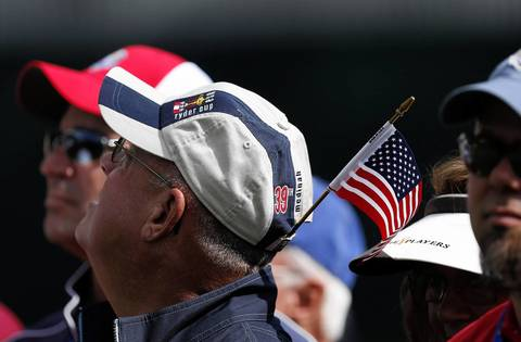 Spectators watch USA Ryder Cup Team members on the first hole during Thursday's practice round at Medinah Country Club.