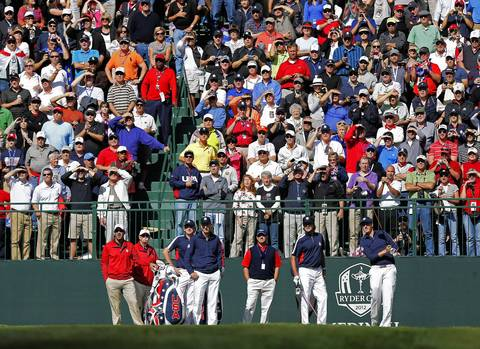 USA Ryder Cup Team member Webb Simpson, right, tees off on the first hole as teammates Bubba Watson, second from right, Jim Furyk, third from right, and Brandt Snedeker, third from left, look on during Thursday's practice round at Medinah Country Club.