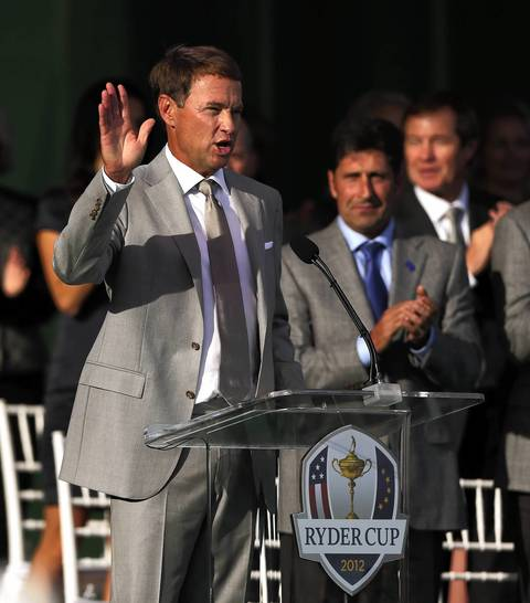 United States captain Davis Love III acknowledges the crowd as European captain Jose Maria Olazabal looks on during the Ryder Cup Opening Ceremonies at the Medinah Country Club in Medinah.