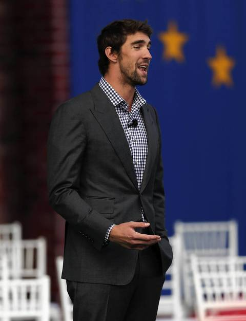 United States Olympian Michael Phelps addresses the crowd during the Ryder Cup Opening Ceremonies at the Medinah Country Club in Medinah.