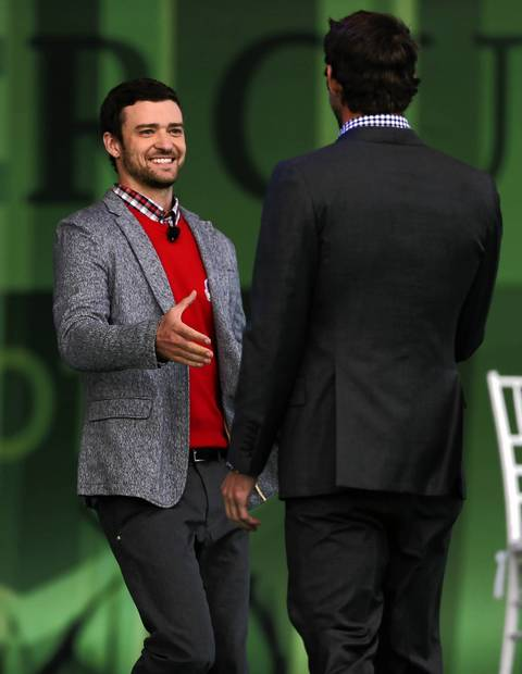Justin Timberlake greets United States' Olympian Michael Phelps during the Ryder Cup Opening Ceremonies at the Medinah Country Club in Medinah.