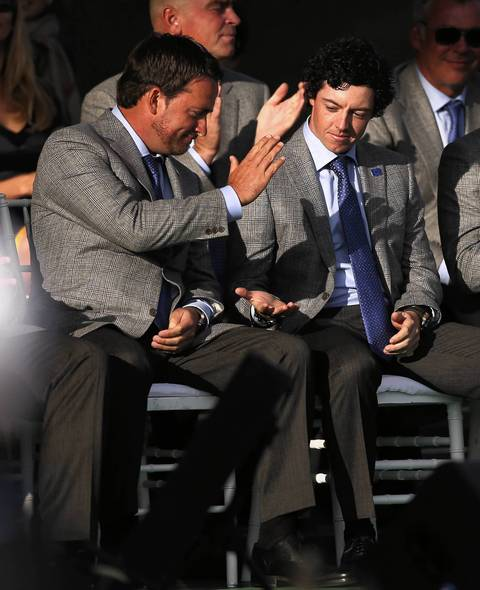Europe's Graeme McDowell and Rory McIlroy slap hands after the announcement that the pair will team up during Friday's foursomes against United States' Jim Furyk and Brandt Snedeker during the Ryder Cup Opening Ceremonies at the Medinah Country Club.