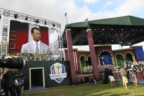 The United States' Tiger Woods and Steve Stricker are announced as partners in Friday's foursome against Europe's Ian Poulter and Justin Rose during the Ryder Cup Opening Ceremonies at the Medinah Country Club.