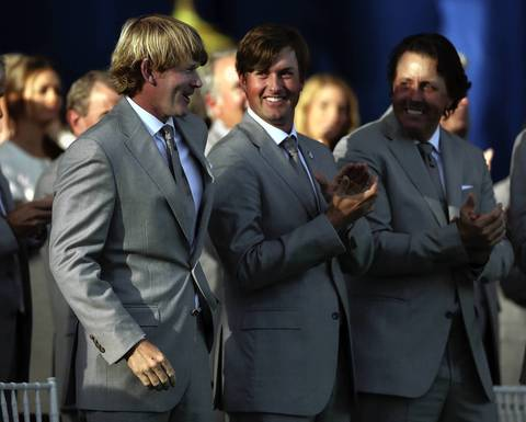 United States team members Brandt Snedeker, Webb Simpson and Phil Mickelson are introduced during the Ryder Cup Opening Ceremonies at the Medinah Country Club.