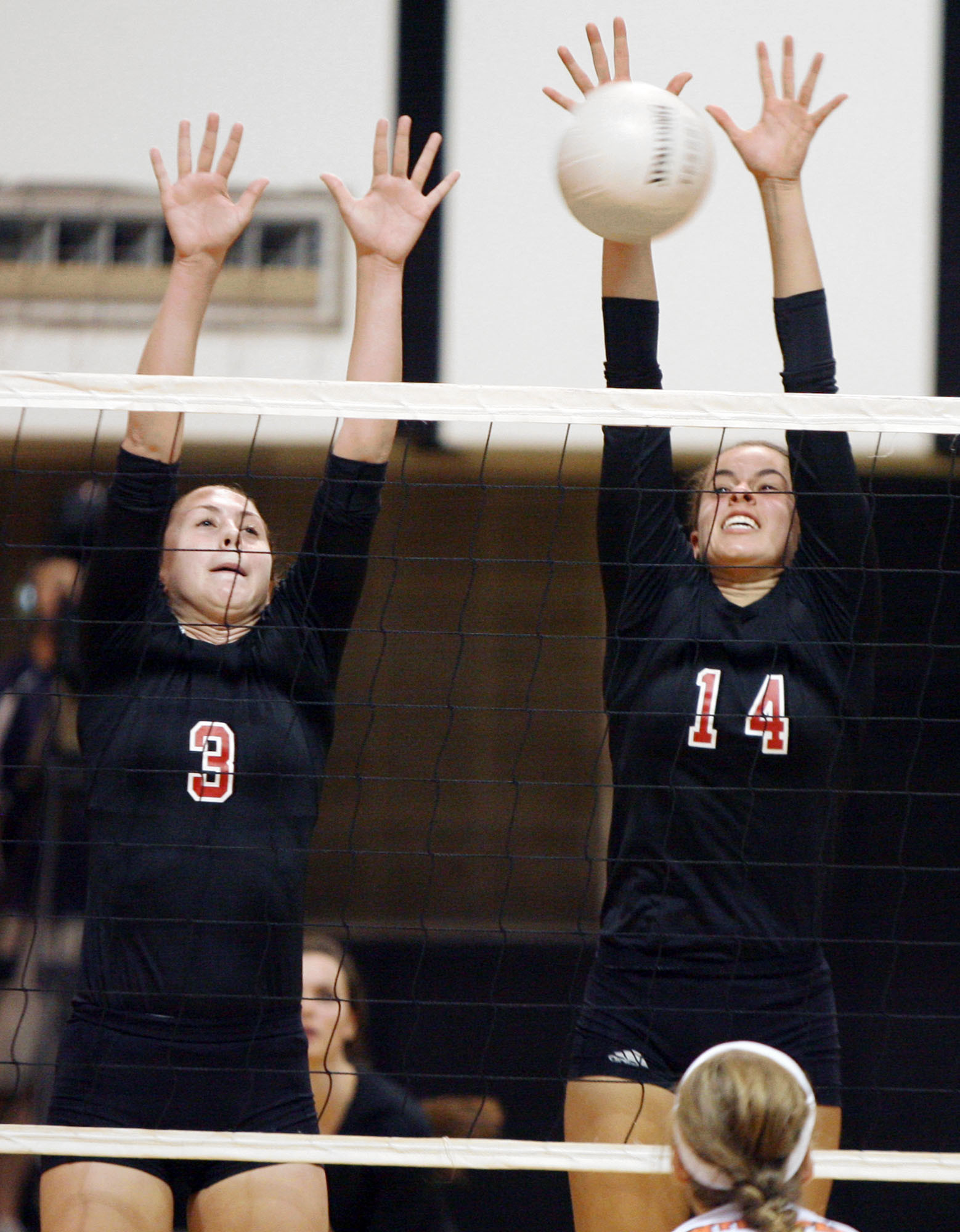 Lake Highland's Emma Turner, left and Vanessa Freire block a shot in a 3-0 sweep over Winter Park on Thursday.