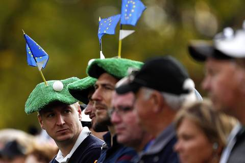 European Ryder Cup fans watch the play during the morning foursome matches at Medinah Country Club.