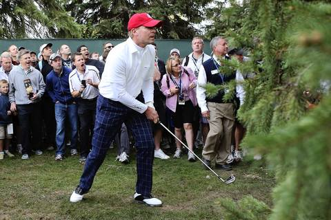 USA Ryder Cup player Steve Stricker hits a shot from the rough on the first hole during the morning foursome matches at Medinah Country Club.