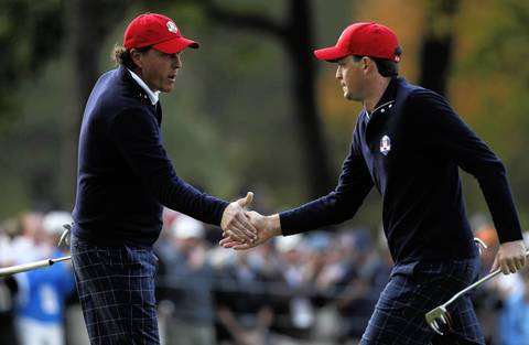 Phil Mickelson, left, celebrates with teammate Keegan Bradley after Bradly makes his putt on the fourth hole during the morning foursomes round at the 39th Ryder Cup at Medinah Country Club.