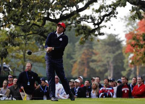 USA Ryder Cup Team member Phil Mickelson tees off on the fourth hole on the first day of competition at Medinah Country Club.