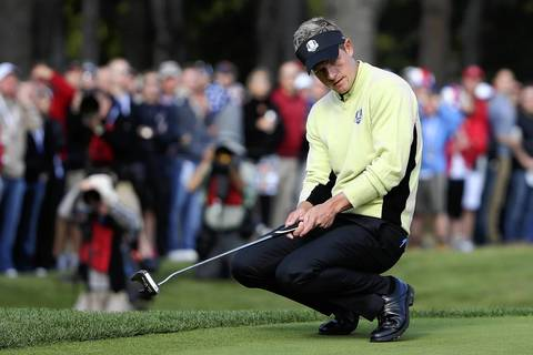 European Ryder Cup player Luke Donald watches a missed putt on the ninth hole during his morning foursome match at Medinah Country Club.