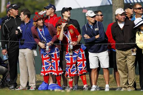 Spectators watch as the first group of USA and European Ryder Cup Team members tee off on the eleventh hole on the first day of competition at the 2012 Ryder Cup.