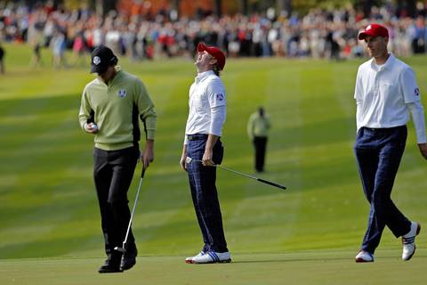 USA Ryder Cup Team member Brandt Snedeker reacts after he misses a putt on the twelveth hole. European Ryder Cup Team member Rory McIlroy walks past him on the left.