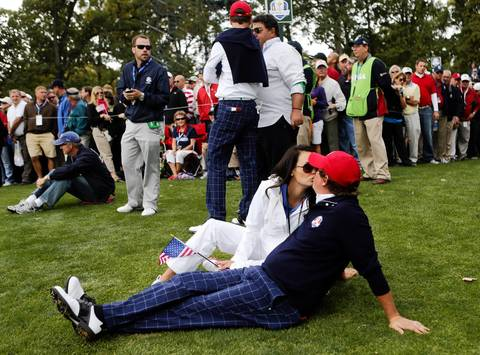 USA's Jason Dufner gets a kiss after winning his Ryder Cup match during the first round at Medinah Country Club.