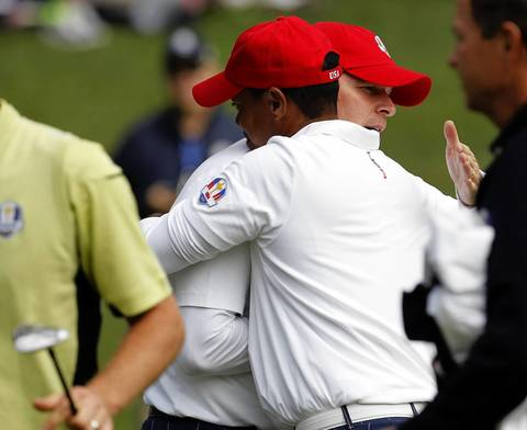 USA's Tiger Woods and Steve Stricker console each after their loss during the first round of the Ryder Cup.