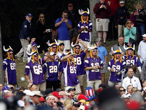 Fans dressed as Vikings cheer at the seventeenth hole during the first round of the Ryder Cup.