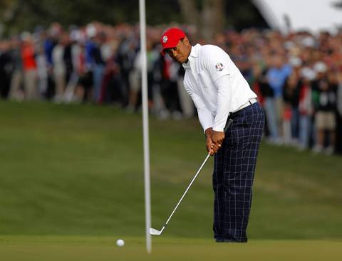Tiger Woods chips to the green on the first hole of the first round of the Ryder Cup.