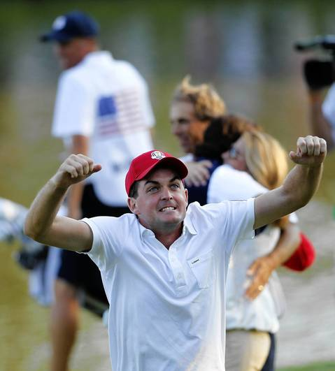 USA Ryder Cup Team members Keegan Bradley celebrates after beating the European Ryder Cup Team on the seventeenth hole in the afternoon fourball play on the first day of competition at the 2012 Ryder Cup taking place at the Medinah Country Club.