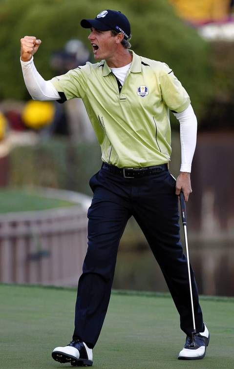 Europe's Nicolas Colsaerts celebrates making a putt on the 17th hole during the afternoon rounds of the first day of the Ryder Cup at Medinah.