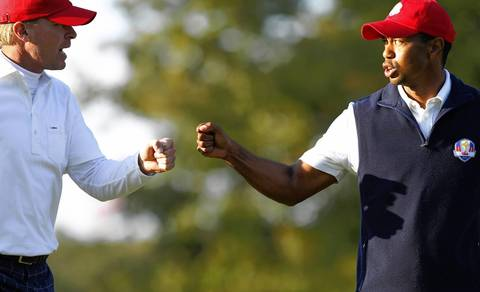 USA's Steve Stricker and Tiger Woods bump fists during the afternoon rounds of the first day of the Ryder Cup at Medinah.