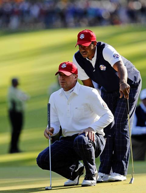 Steve Stricker and Tiger Woods during the afternoon rounds of the first day of the Ryder Cup at Medinah.