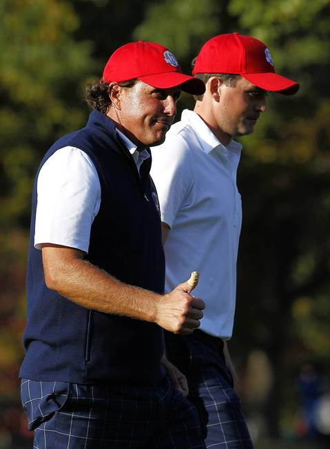 USA Ryder Cup Team member Phil Mickelson gives a thumbs up as he walks with teammate Keegan Bradley on the fourteenth hole on the afternoon fourball session on the first day of competition at the 2012 Ryder Cup taking place at the Medinah Country Club.