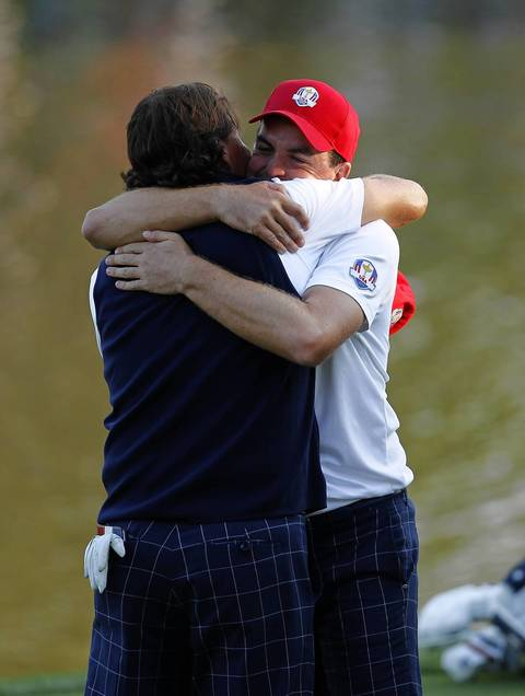 USA Ryder Cup Team members Keegan Bradley goes to embrace teammate Phil Mickelson after beating the European Ryder Cup Team on the seventeenth hole in the afternoon fourball play on the first day of competition at the 2012 Ryder Cup taking place at the Medinah Country Club.
